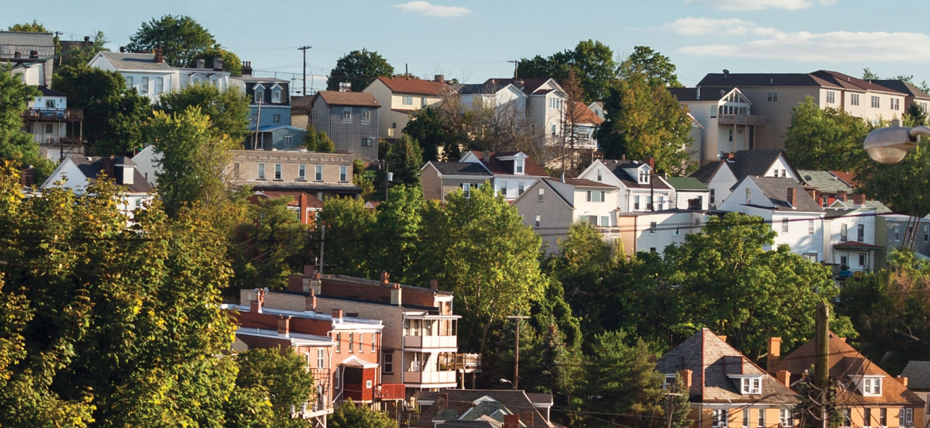 The rooftops of homes in a Pittsburgh neighborhood