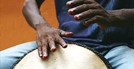 A person plays a drum