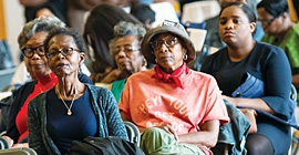 Community residents listen during a presentation