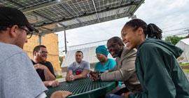 Community members gather in Homewood, a Pittsburgh neighborhood